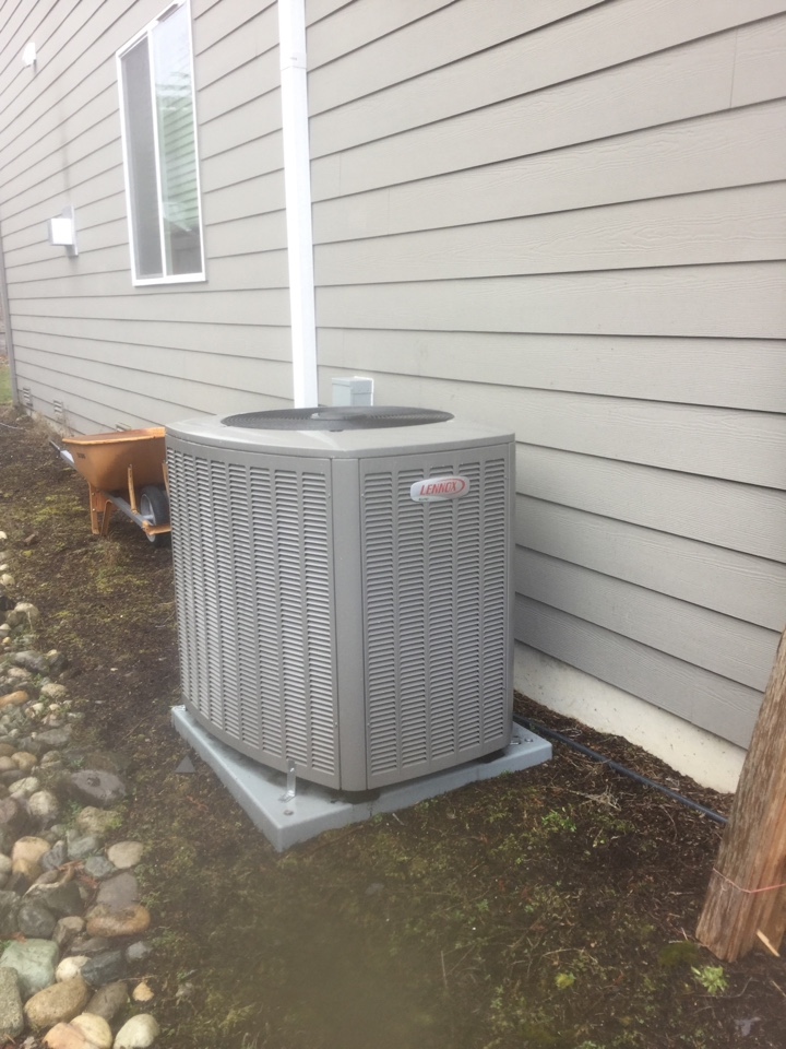 Bothell, WA - Performing a planned maintenance on a Lennox heat pump in Bothell, WA
