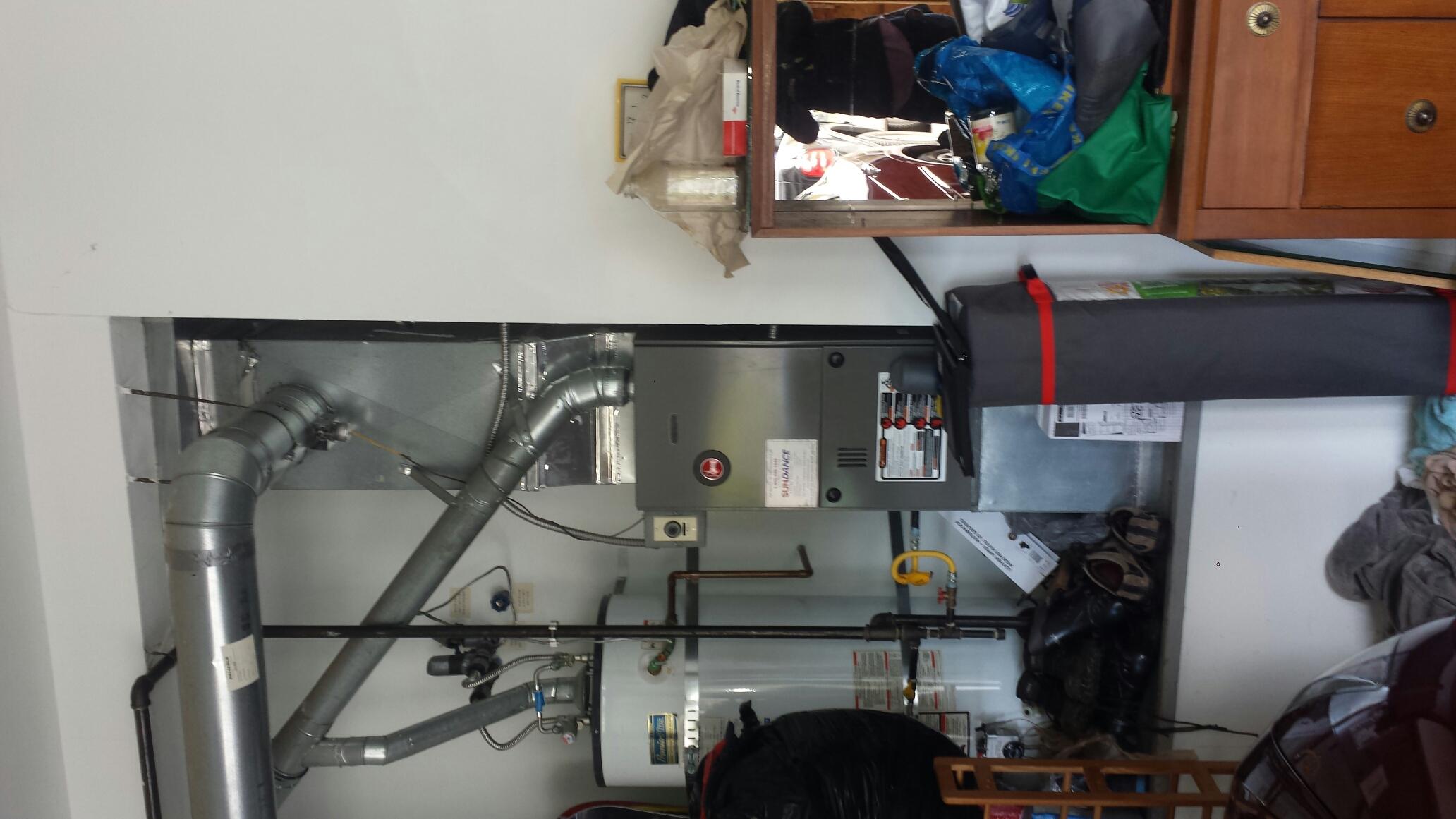 Repairing Rheem furnace in Lynnwood.