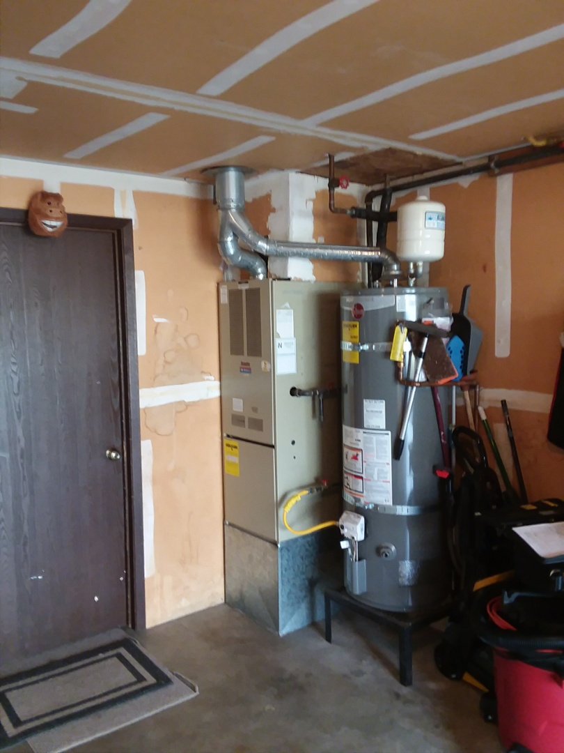 Marysville, WA - Replacing an old Arcoaire furnace with a new Lennox Signature Series SLP98 modulating variable speed 98% furnace in Marysville.