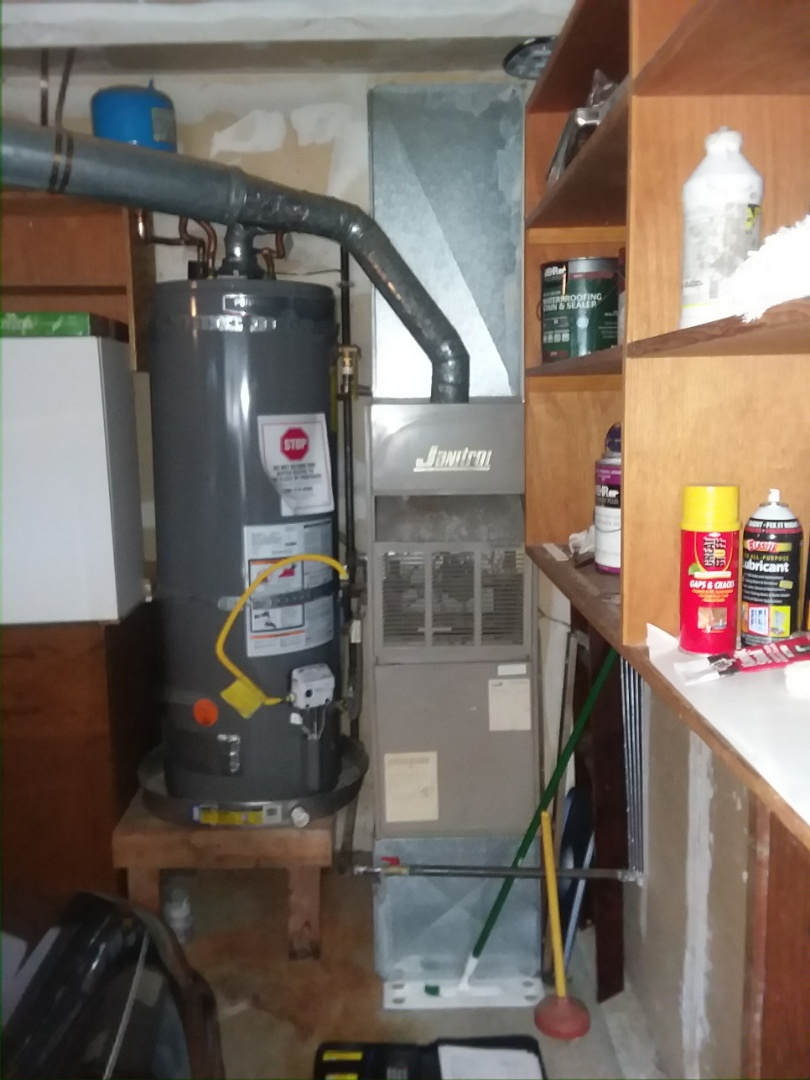Mukilteo, WA - Providing an estimate to replace this Janitrol furnace with a new Lennox Elite Series furnace in Mukilteo.