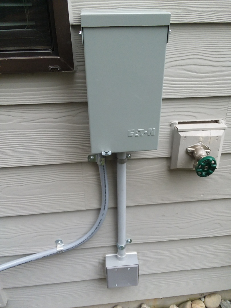 Lynnwood, WA - Running a dedicated 30 amp electrical circuit for a Lennox air conditioner. Installing a Eaton Air Conditioner disconnect with built in GFCI protected weather rated outlet.