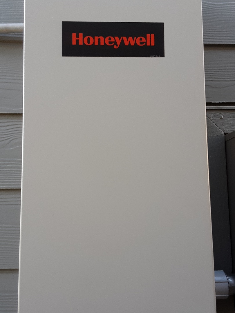 Lake Stevens, WA - Installing a 20kw honeywell home generator with automatic transfer switch. Installing two outdoor weather rated GFCI protected outlet