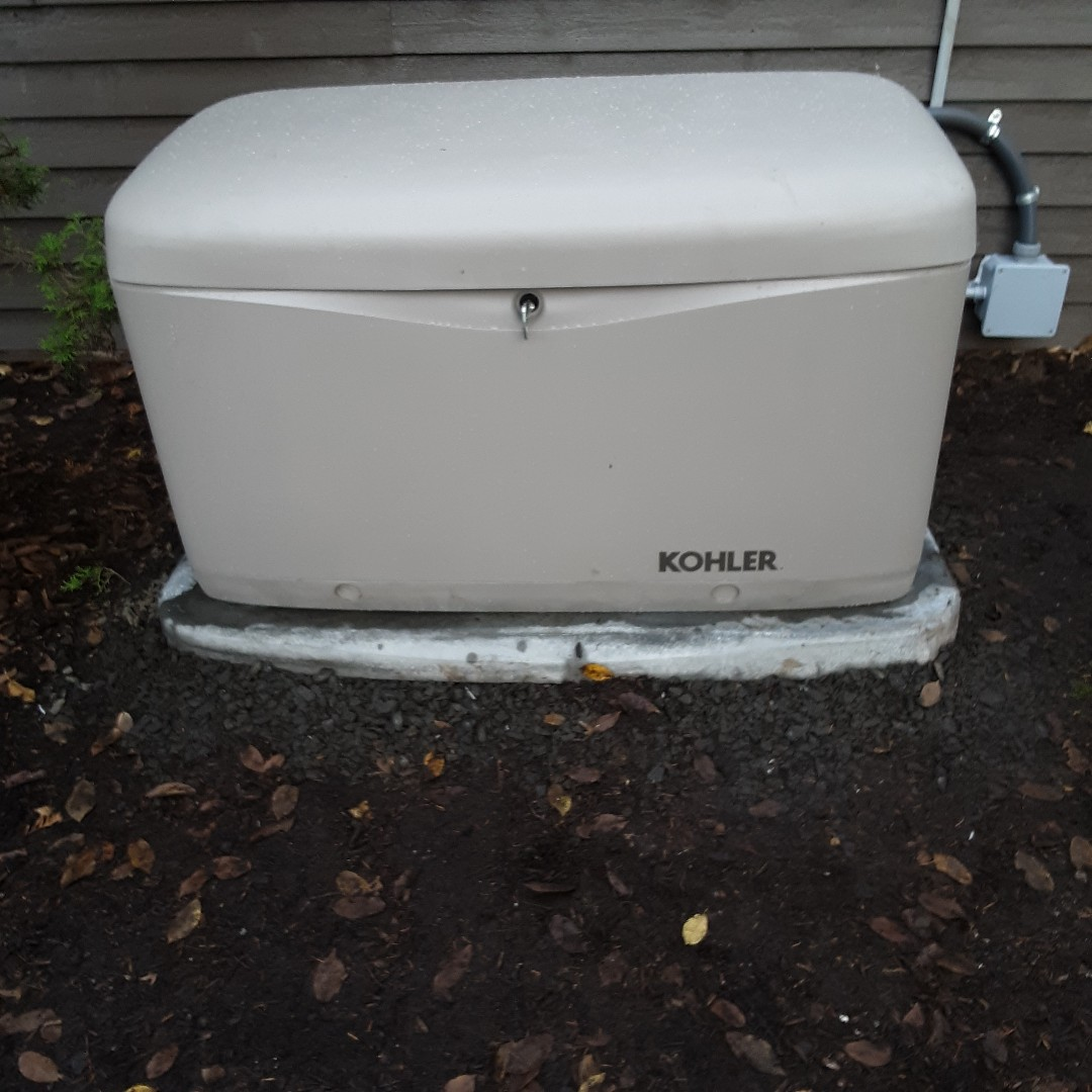 Redmond, WA - Installing a 20 kw Kohler automatic home stand bye generator with automatic transfer switch. Installing a load shed module for the generator. Updating the bonding and grounding up to nec code.