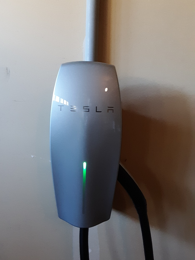 Lynnwood, WA - Running a dedicated 60 amp electrical circuit for a Tesla car charger. Installing and wiring up the car charger and testing for proper function