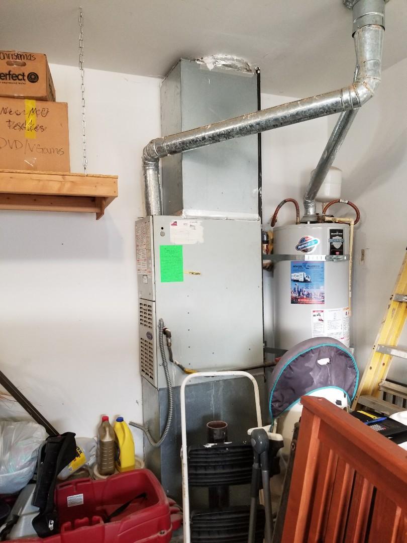 Lynnwood, WA - Providing an estimate to install a Lennox Elite Series EL16 air conditioner in Arlington.