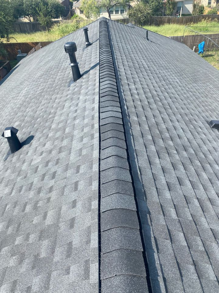 San Antonio, TX - Final walk through of a new roof paid for by the insurance. GAF HDZ Charcoal with enhanced ridge vent.