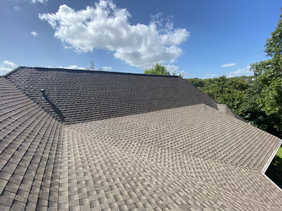 San Antonio, TX - Brand  new beautiful roof 76 square roof with detached garage. GAF HDZ Weatherwood replacement after a huge haul storm.