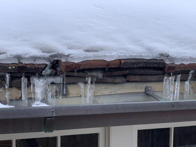Denver, CO - New Line Roofing was contacted by a Denver Realtor looking for a Denver roofing contractor to inspect a leaky tile residential roof.  We arrived and upon inspection found a tile roof with multiple layers and hail damage to the metal coping cap and gutters.  Repair agreement is signed and inspection are forthcoming once we get some decent weather.