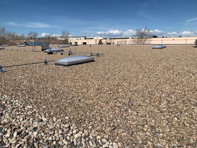 Aurora, CO - Commercial property management company called in looking for a Denver commercial roofing company to inspect a flat EPDM roof for leaks. We located several curb flashings that opened up.  We made the correct EPDM repair.  Property manager and tenant are happy.