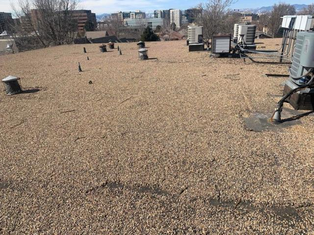 Denver, CO - Property manager called in to the office looking for a commercial roofing contractor in Denver to take a look at a roof the manage for a local HOA.  Homeowners in several of the apartments have been experiencing leaks.  We provided a no obligation, free inspection and free roof evaluation report.  We found 3 curbs in need of restoration.  They signed with New Line Roofing to do the repairs.  We will be making the repairs to the apartment by prepping the surface, removing anything wet and or deteriorated and then reinstalling the curb flashings.  All repairs will be warranted to be free from leaks.