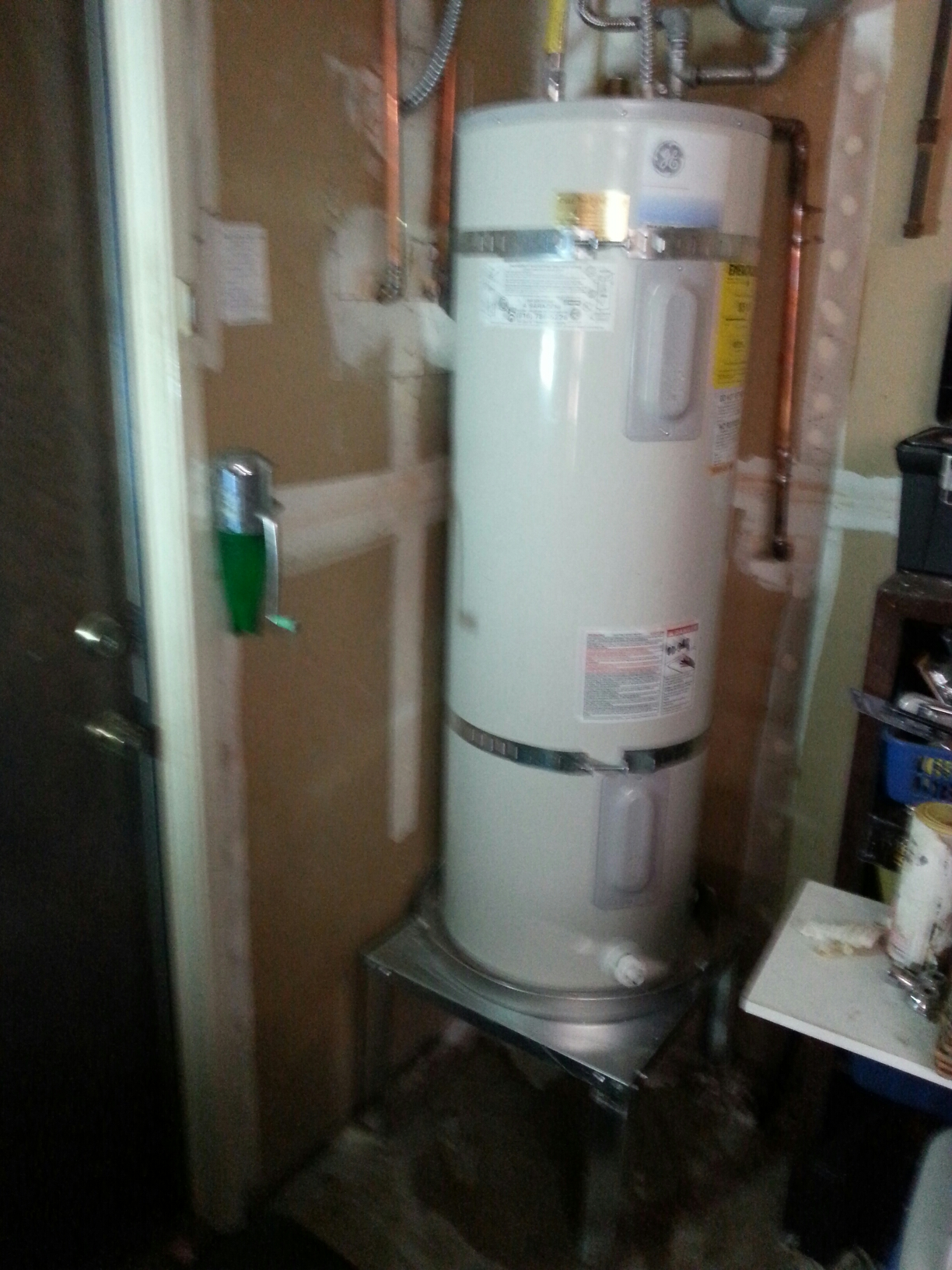 Roseville, CA - Roseville water heater new stand and water pan. Plumbed water heater up to code.