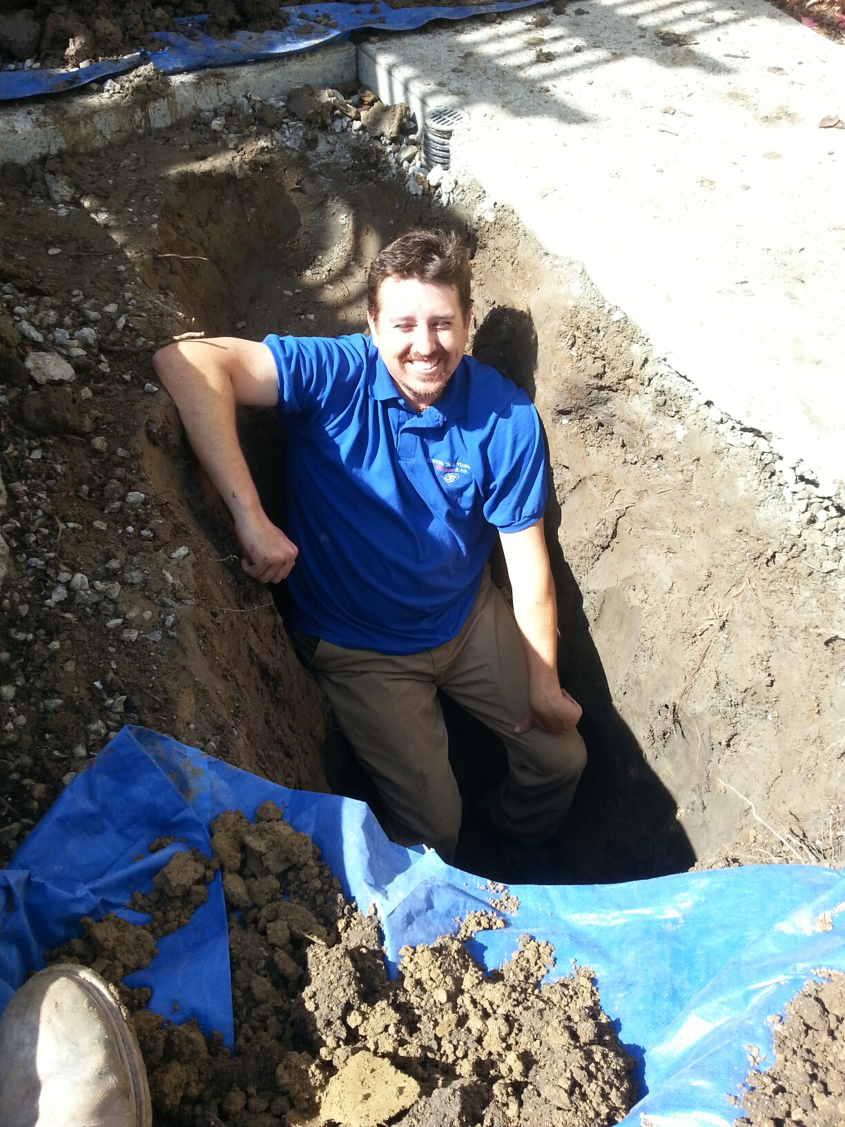 El grove water leak. dig 5 foot hole in a trench to locate a leaky pipe in ground