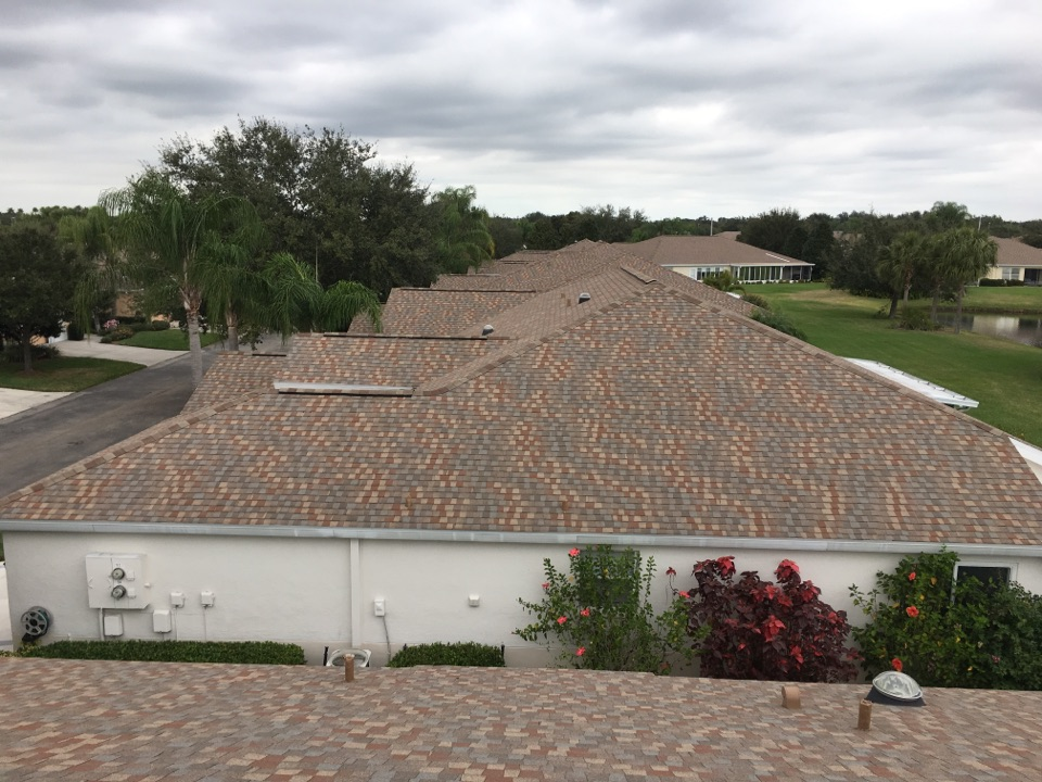 Sun City Center, FL - Quality roofers performing roof replacement on 41 duplexes in Sun City Center, Florida. Solved future leak problems with 50 year dimensional shingles and ten-year workmanship warranty