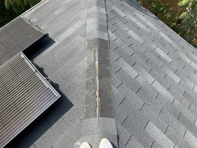 Austin, TX - Roof inspection in Austin Texas for missing shingles on top of roof.