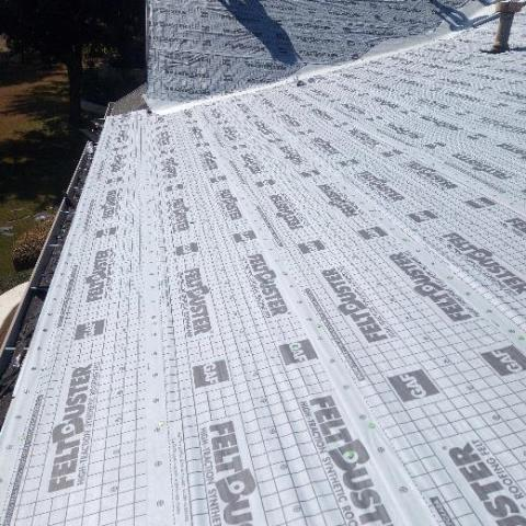 Georgetown, TX - Double underlayment being installed on a roof installation in Sun City neighborhood of Georgetown Texas. Required for code and manufacturer due to the lower slope pitch of the roof.