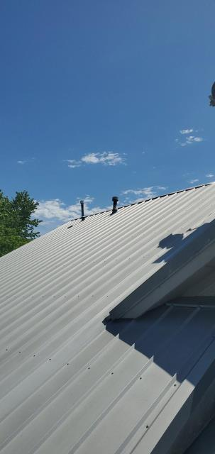 Liberty Hill, TX - Roofing Company in Liberty Hill Texas that repairs metal roofs with active leak. Texas Traditions Roofing is you central Texas local licensed and insured roofing company for Metal and Shingle roof repairs and replacements.