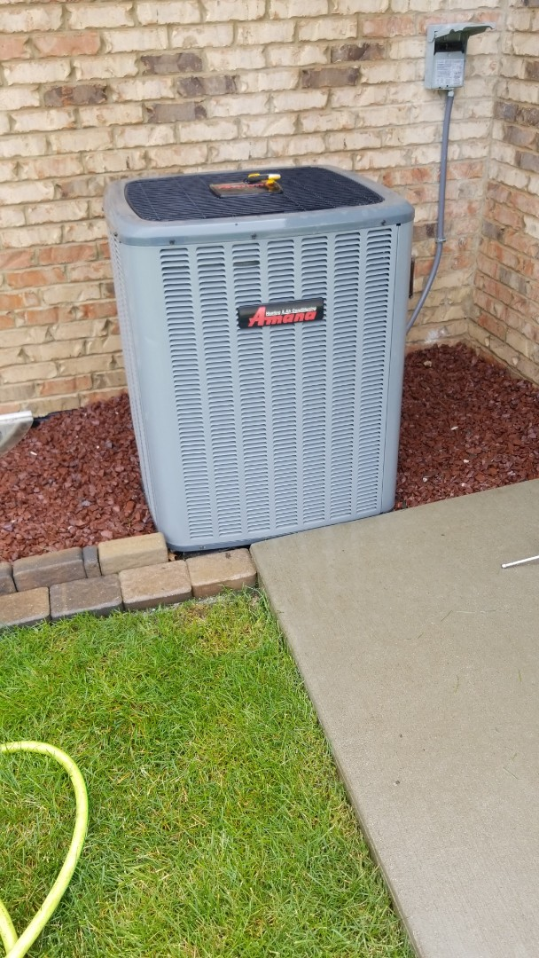 Crown Point, IN - Airconditioning maintenance on Amana airconditioning condenser