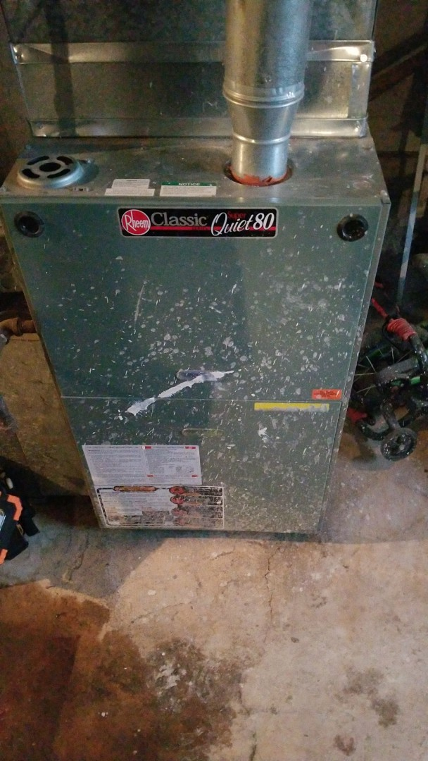 Chicago Heights, IL - Adjust thermostat and clean sensor on Rheem furnace