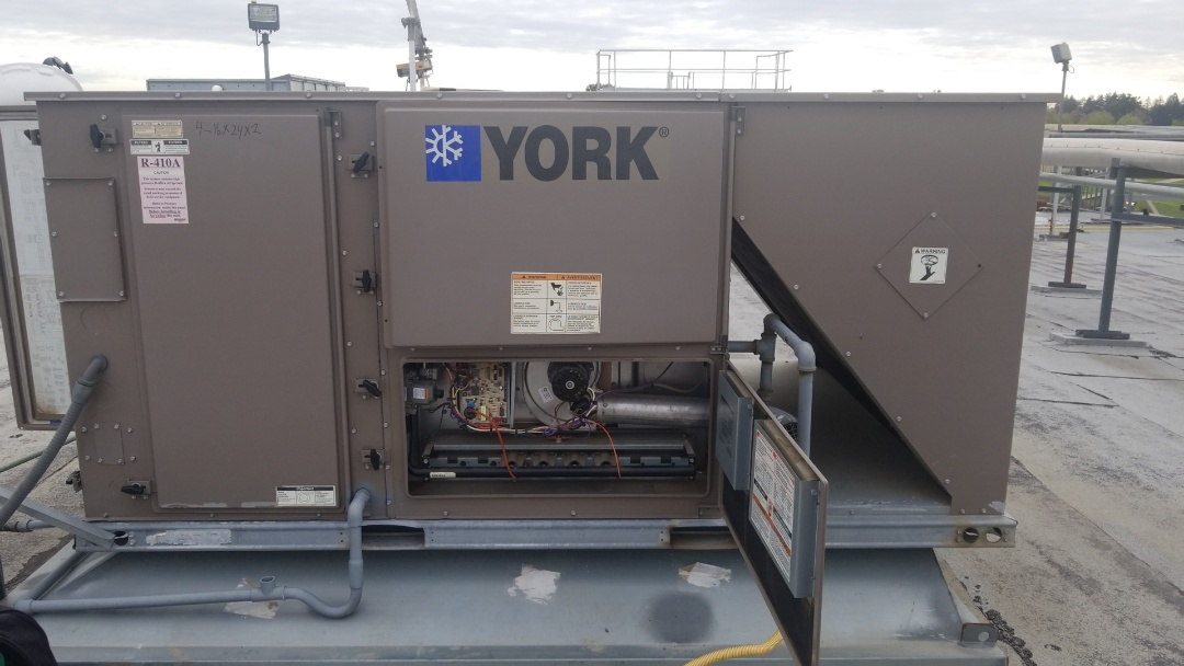 Turlock, CA - Spring maintenance on commercial sized HVAC equipment.