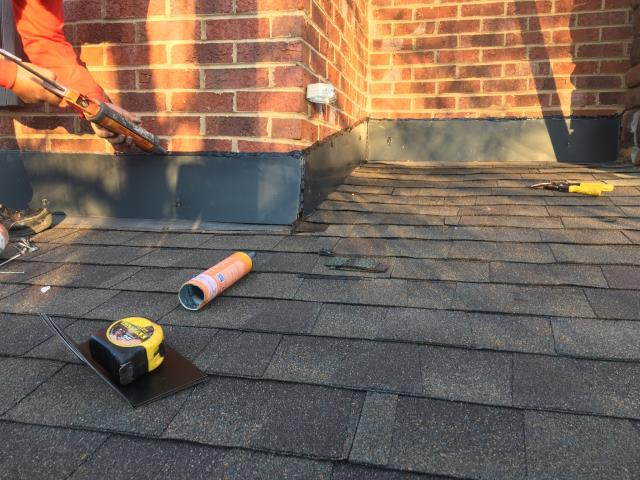 "Charlotte, NC - Putting the finishing touches on a MAJOR roof repair.  The leak and decayed OSB decking was due to improper roof installation and inadequate rain water disbursement system.  After replacing decayed decking boards, GAF ""Weatherwatch"" Leak Barrier was installed under new shingles.  Finally, making the flashings weather tight."