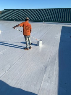 Locust, NC - Renovating a leaky roof over a middle school.  ER Systems repair system over EPDM.  WOW!  Is that bright!