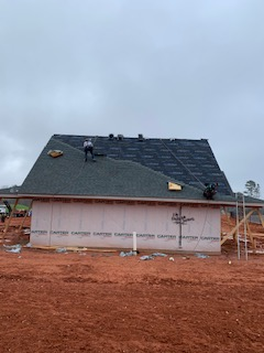 Fort Mill, SC - The excitement is building!  GAF-WeatherWatch, Felt Buster, Prostart, Timberline Architectural Shingles, Cobre 3, Timbertex ridge cap and Copper half round roof panels on the dormers!  That was a mouth full!  Check in later to see the finished house.
