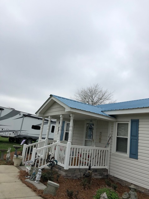 "Gastonia, NC - Installed new CMP Metal Roofing system in Hawiian Blue over GAF ""FeltBuster"" synthetic deck protection.  GAf ""Cobra"" vent ridge