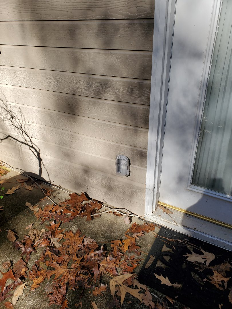 Fayetteville, GA - Customer had outdoor receptacle that had gotten wet over time, and its connections were all corroded. Replace the receptacle and added a new bubble cover to keep it dry.
