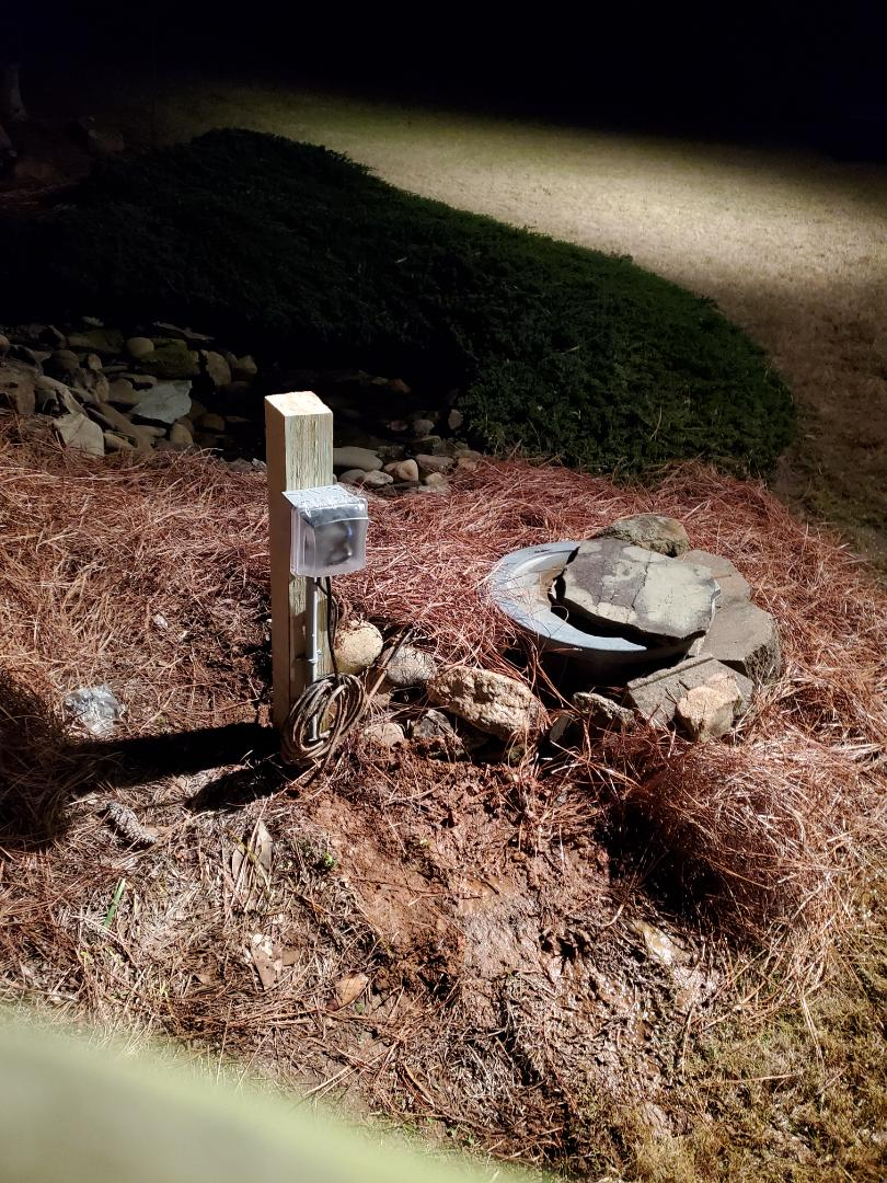 McDonough, GA - Installed a new circuit for a customer's pond pumps. Now their waterfall is working again.