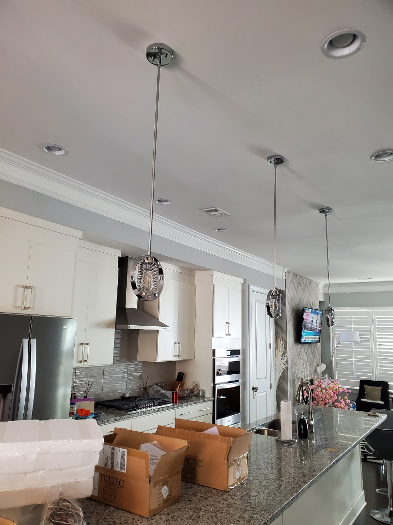 Brookhaven, GA - Install three light fixtures for a customer over their kitchen island.