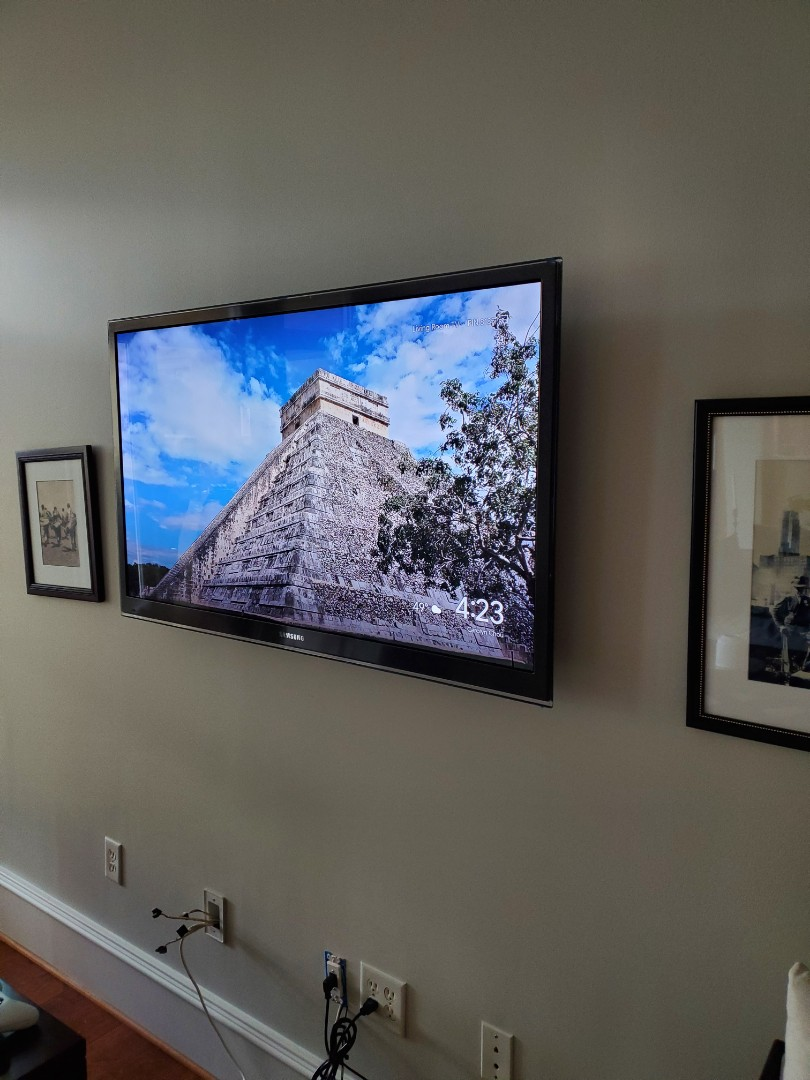 Installed a receptacle behind a customer's wall mounted flat screen TV. Helped get rid of those unsightly cords.