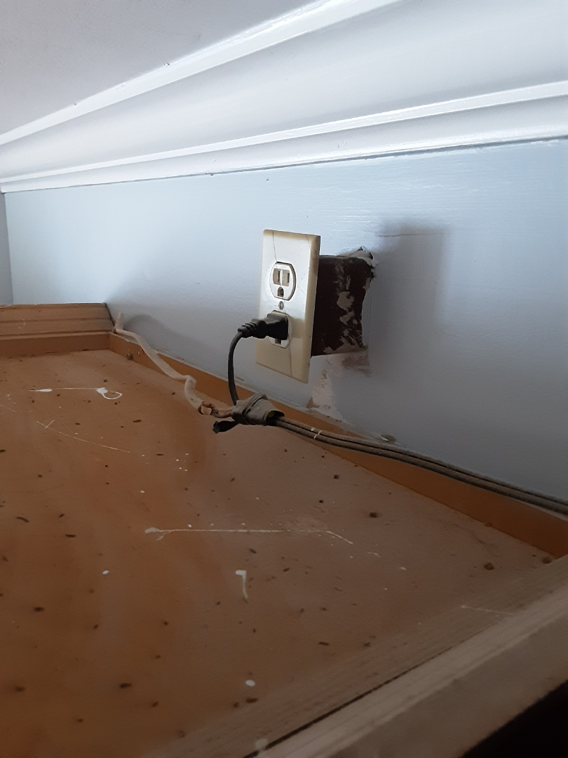 Newnan, GA - Junction points in wiring must be done inside of a junction box. It can't just be hidden above cabinets in your kitchen.