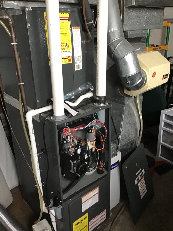 Monroe, MI - Heating maintenance on a Goodman furnace. On tune ups be sure to replace your media filter and humidifier pad.