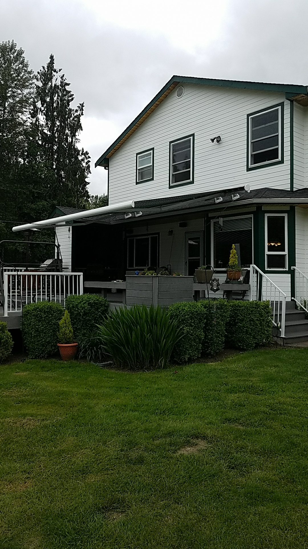 Snohomish, WA - Installing a twenty foot, somfy motorized, roof mount, NuImage G250 semi cassette lateral arm awning.