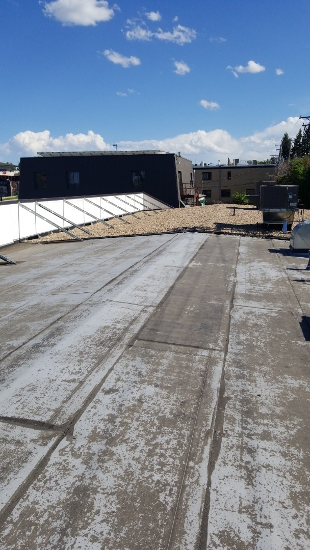Denver, CO - Evaluating a low sloped roof in Denver Colorado to decide whether it needs roof coating or complete re-roof.