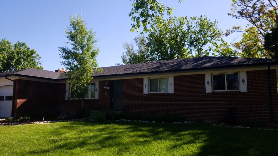 Littleton, CO - Completed a re-roof. Installed Owens Corning Duration Storm in Onyx Black with new black gutters and downspouts
