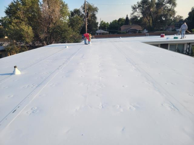 Lakewood, CO - Completed the removal of deteriorated EPDM from a flat roof with depressions that allowed for standing water and removed rusted gutters. Replaced with tapered foam and TPO allowing for the water to flow off the roof in all directions into new white, 6 inch gutters.