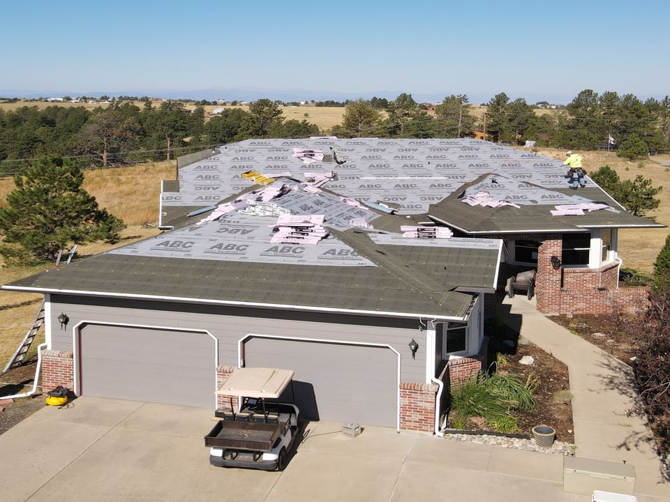 Parker, CO - Installing a new asphalt shingle roof in Parker, Colorado (Elbert County) using Owens Corning Duration in Estate Gray. A beautiful day for working on a roof.