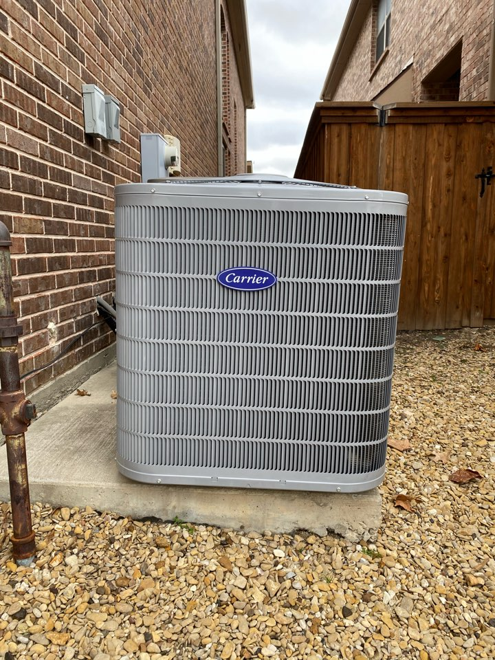 Lewisville, TX - Quality check on a new Carrier HVAC gas system.