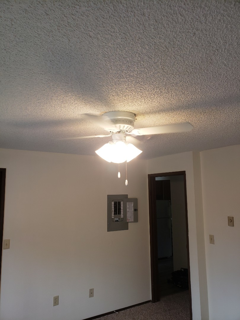 Lakewood, WA - Replaced existing light with paddle fan. Removed bakelite light box and upgraded with a ceiling fan support box with brace kit to support the weight of the ceiling fan and minimizing any fan wobble. Apt N10