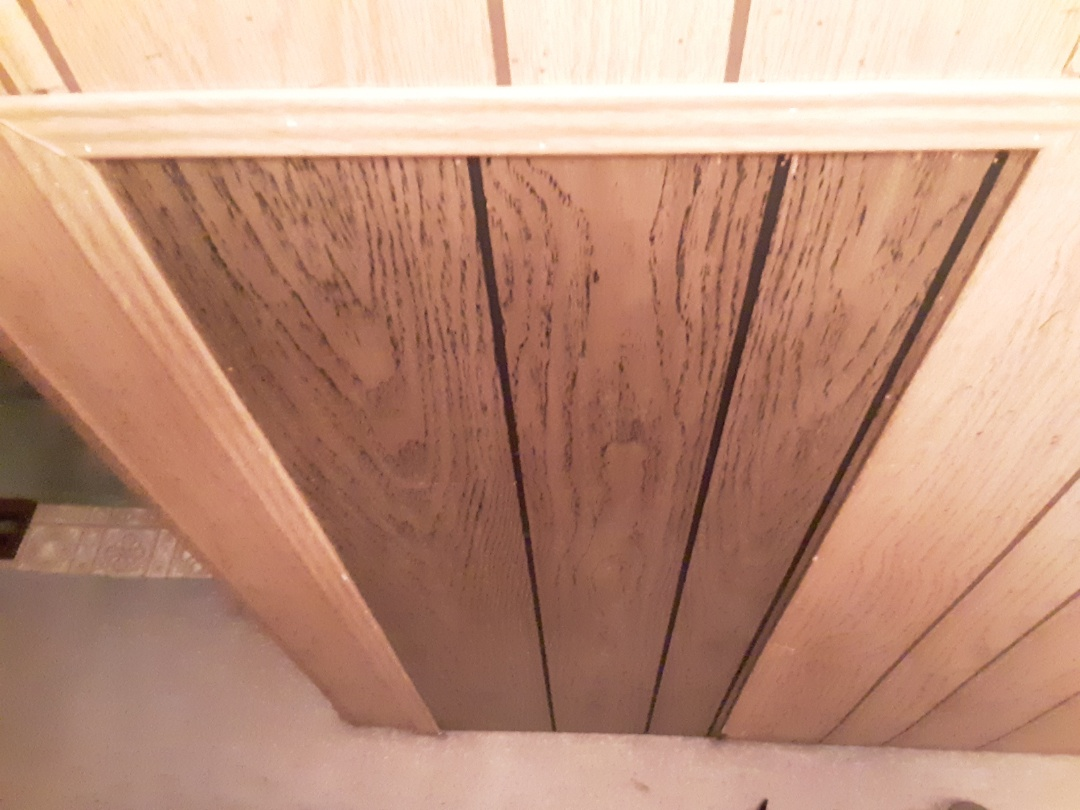 Federal Way, WA - Repairing wood paneling after Mitsubishi split system install