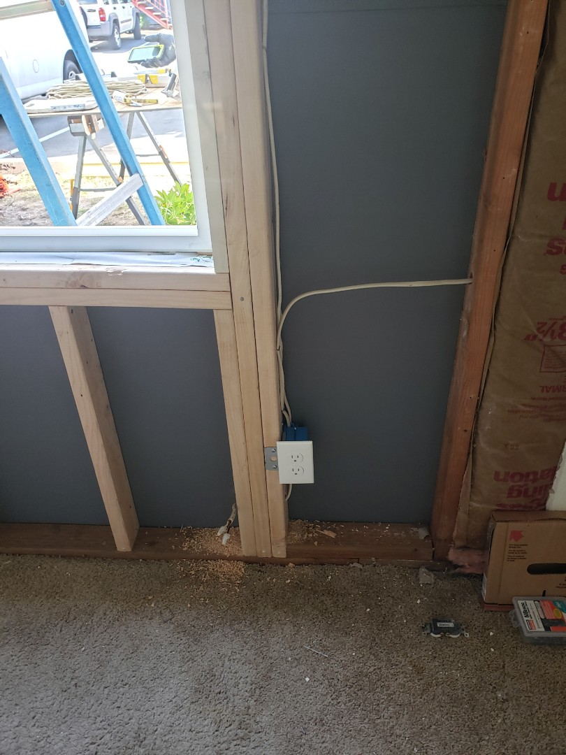 Auburn, WA - Repaired outlet and baseboard heat wire to damaged wall