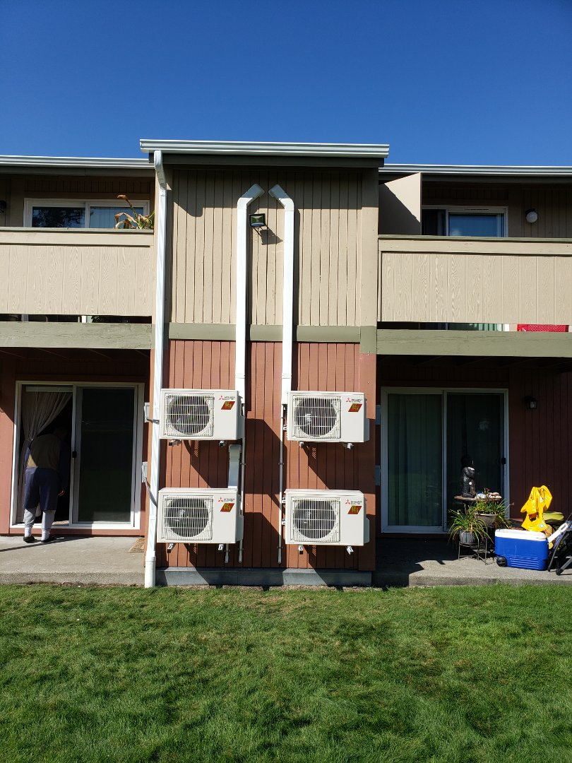Tacoma, WA - Installing Mitsubishi 12k hyper heat ductless systems in apartment complex in Lakewood