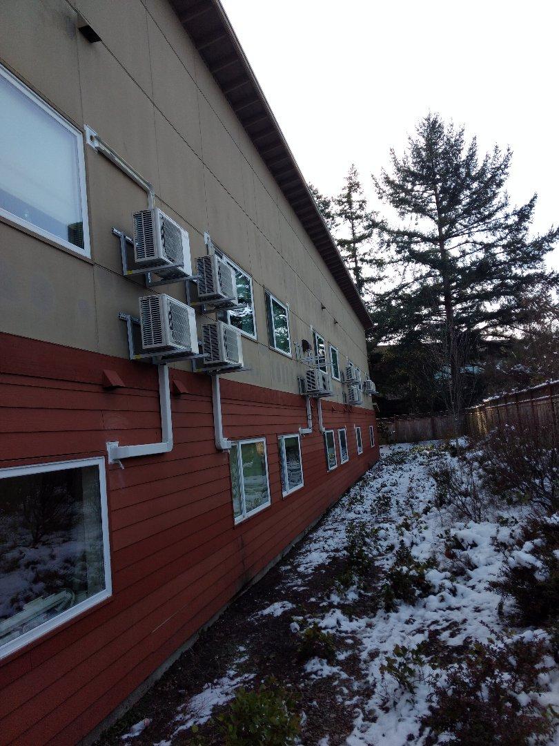 Burien, WA - Energy efficient ductless heat pump installation at apartment complex
