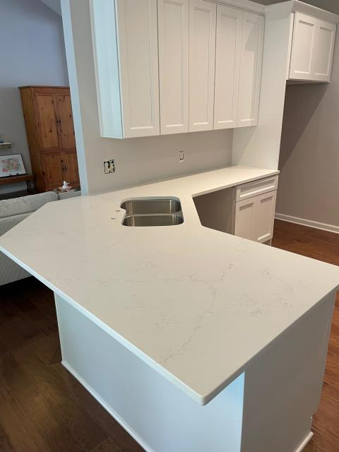 countertop install of Carrara Alaska quartz