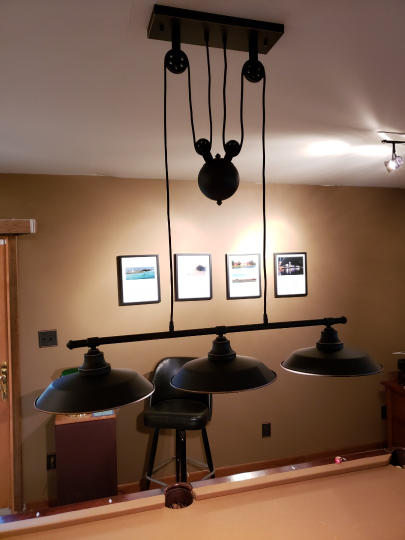 Installed multiple light fixtures and smiles