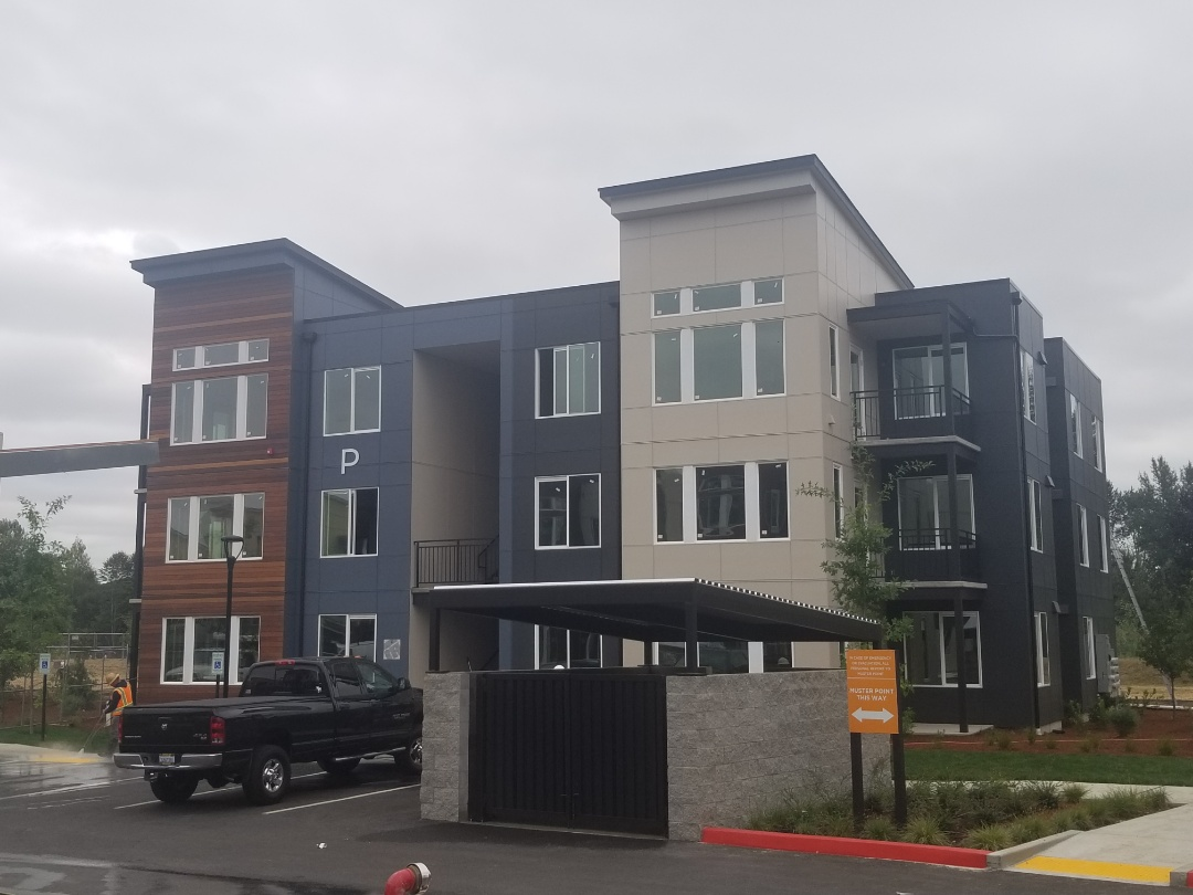 "Kent, WA - Completed building at the Ethos Community Project on Meeket. Siding consists  of ""James Hardie Panel"", ""Easy Trim Reveals"", and Exotic Woods Prefinished Ipe wooding siding."