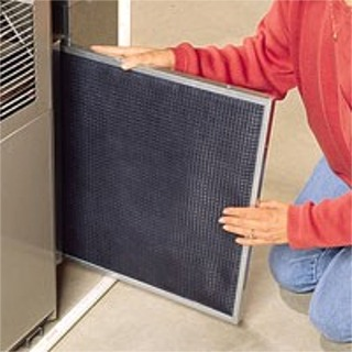 Air Conditioning 17 point maintenance check and change system filters for a residence in Carteret, NJ.