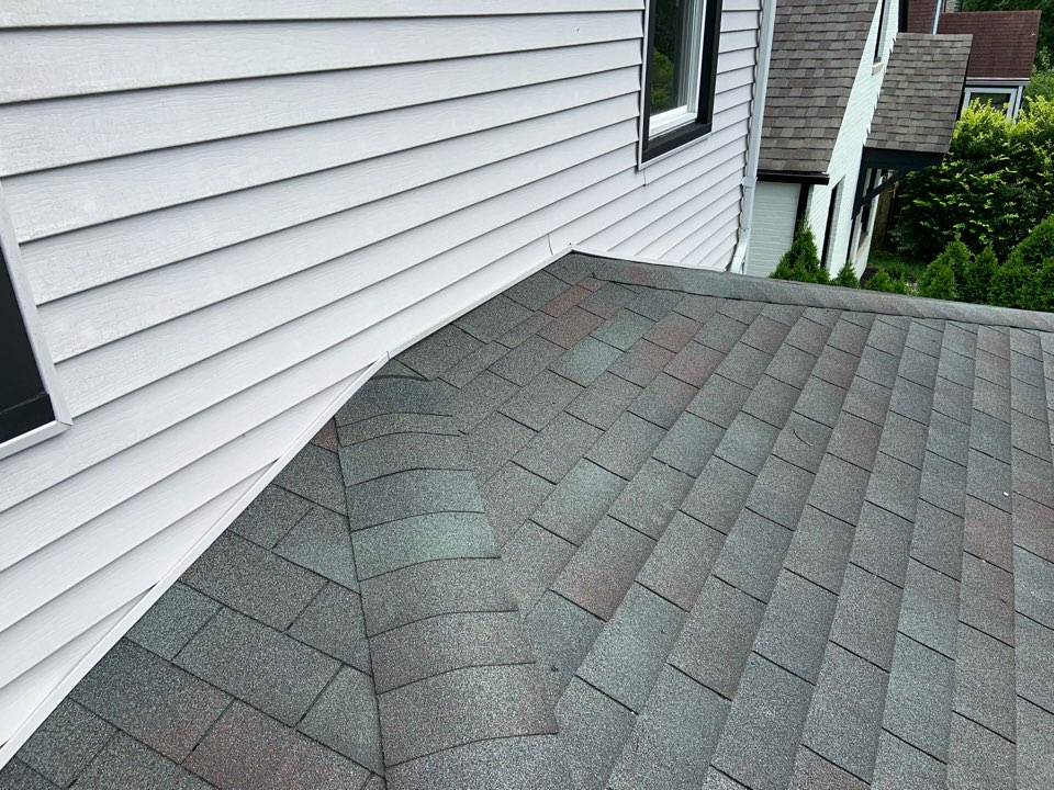 Columbus, OH - New shingle roof estimate.  Roof is only 12 years old, installed by a local competitor.  Metal step flashing and counter flashing was never installed and has leaked ever since roof was installed.