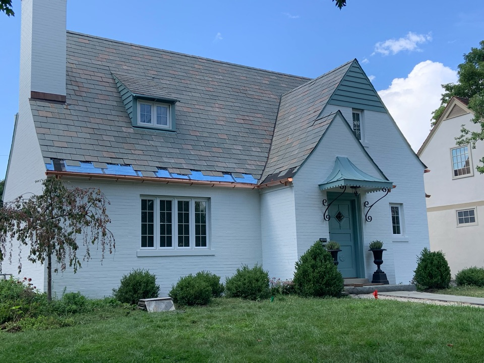 Columbus, OH - Half round copper gutters being hung in Upper Arlington….